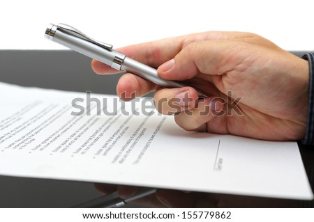 Businessman offering  a pen to sign a contract - stock photo