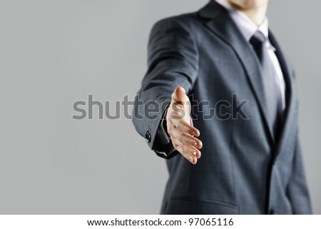 Businessman offering for handshake, close up hand - stock photo