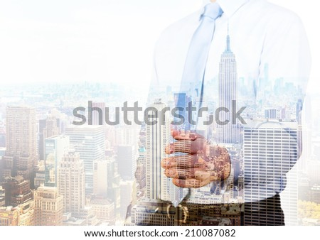 Businessman offering for handshake, modern city background  - stock photo