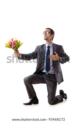 Businessman offering tulip flowers - stock photo