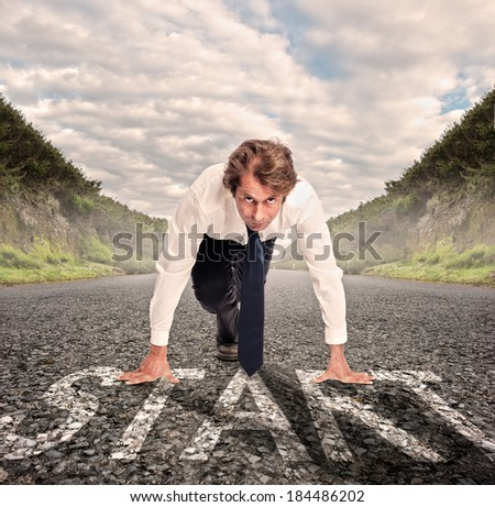 businessman on a road ready to run. Motivation concept - stock photo