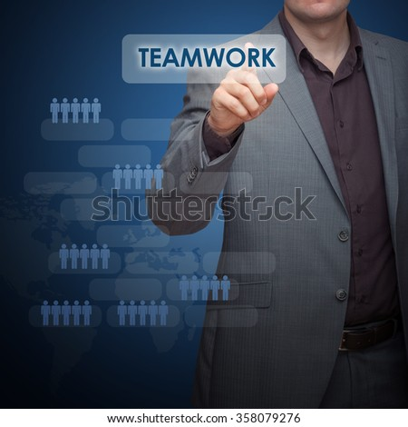 Businessman on blue background pushing a button. No face