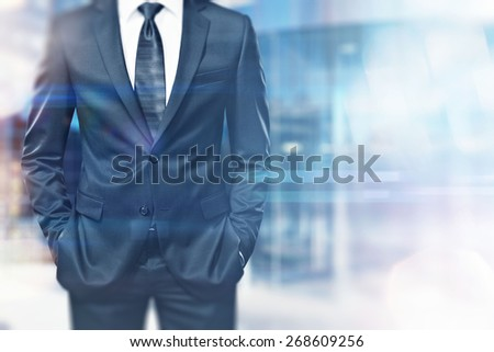 Businessman on blurred city background with special effects - stock photo