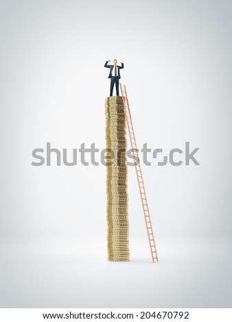 Businessman on coin pile - stock photo