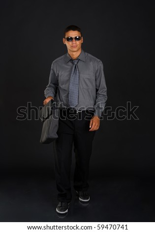 Businessman on dark background