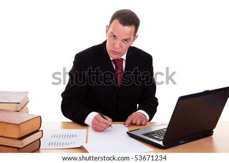 businessman on desk with books and computer, working, isolated on white background, studio shot. - stock photo