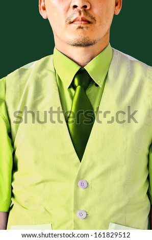 businessman on green background - stock photo