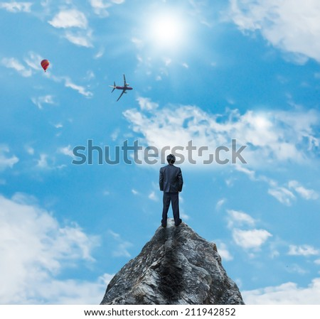 Businessman on highest place - stock photo