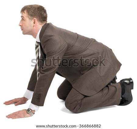Businessman on knees and arms