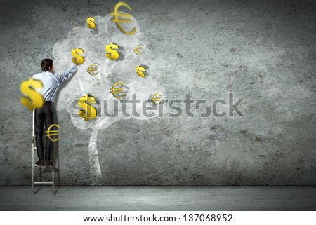 Businessman on ladder pointing at illustrated money tree - stock photo