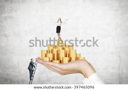 Businessman on ladder trying to reach hand with golden coins, businesswoman on top. Concrete background. Concept of career growth. - stock photo
