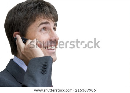 Businessman on mobile phone, smiling, close-up, cut out