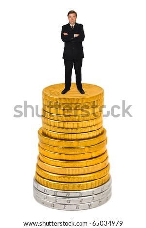 Businessman on money stack isolated on white background - stock photo