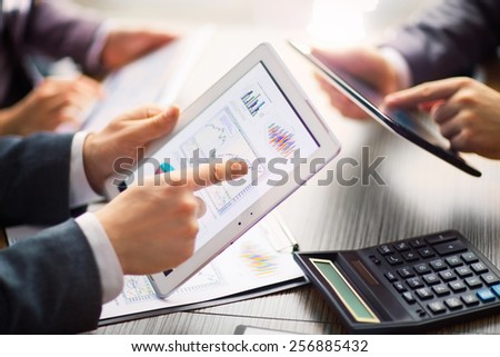 Businessman on online Financial Assessment on a tablet . Team work in the office - stock photo