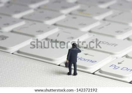 Businessman on PC. - stock photo
