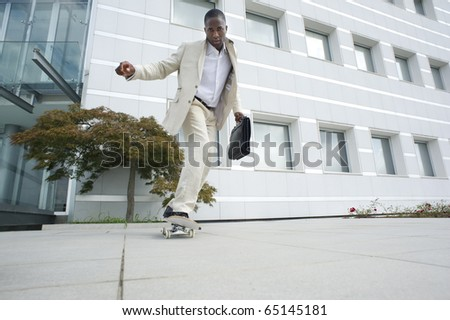 Businessman on skateboard; could be a ecological mode of transport