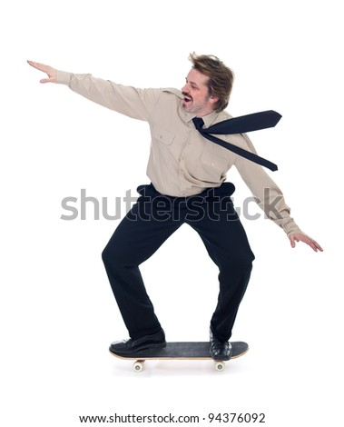 Businessman on skateboard enjoying speed - isolated - stock photo