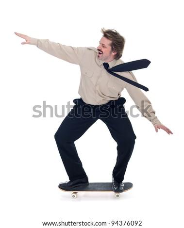 Businessman on skateboard enjoying speed - isolated - stock photo