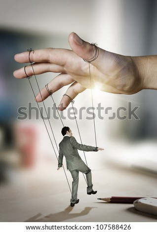 Businessman On Strings. Conceptual photography - stock photo