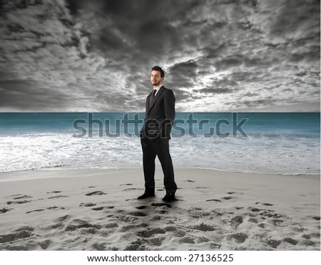 businessman on the beach - stock photo