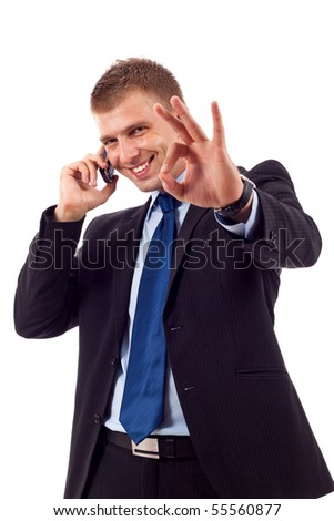 businessman on the phone approving the good news - stock photo