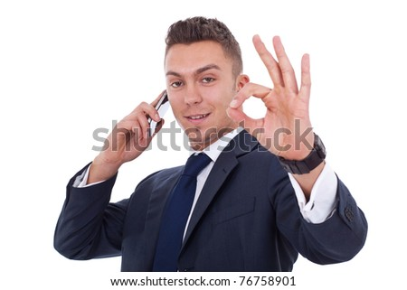 businessman on the phone approving the good news