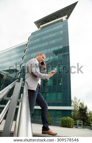 Businessman on the street with Tablet and smart phone  - stock photo