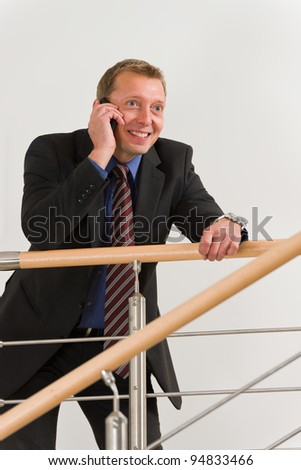 Businessman on the suit use his mobile. - stock photo
