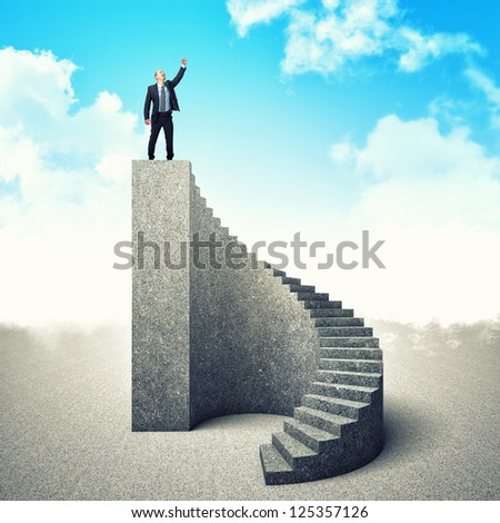 businessman on the top of concrete stair - stock photo
