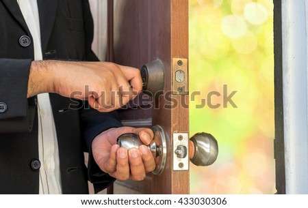 businessman open the door by key for abstract bokeh light - can use to display or montage or product or concept of  refresh feel - stock photo