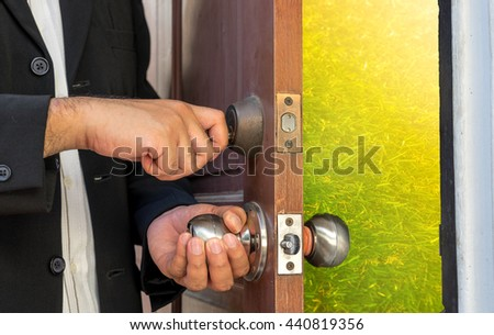 businessman open the door by key to abstract field on sun light - can use to display or montage on product or concept about rice for rich - stock photo