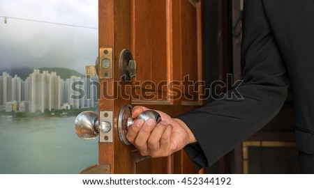 businessman open the door to new world building and sea on hong kong - can use to display or montage on products - stock photo