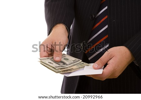 businessman opening a envelope and counting his money (selective focus) - stock photo