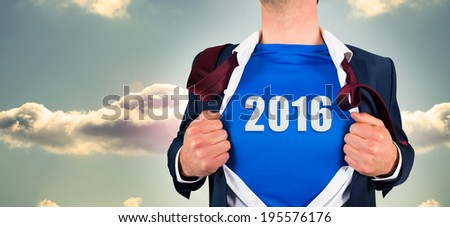 Businessman opening his shirt superhero style against bright blue sky with cloud - stock photo
