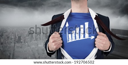 Businessman opening his shirt superhero style against gloomy city