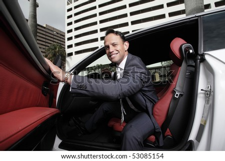 Businessman opening the door to his car and smiling