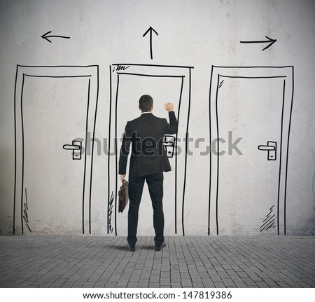 Businessman opens a door designed in a wall - stock photo