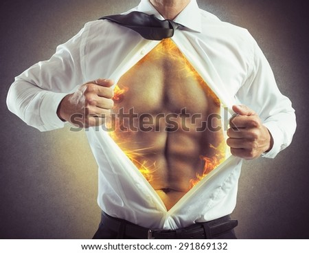 Businessman opens shirt with abs of fire - stock photo