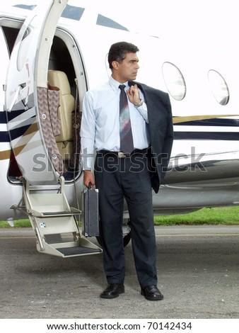 Businessman outside his private plane. - stock photo