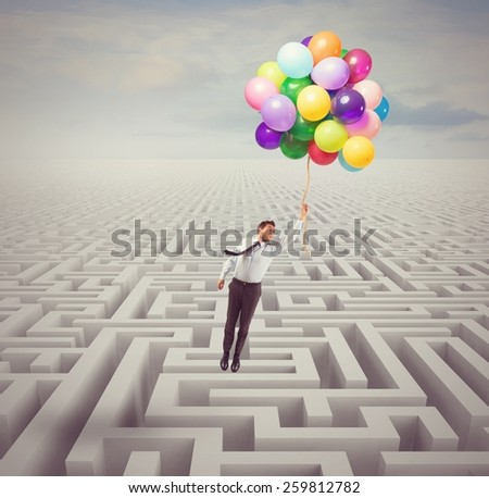 Businessman overcomes obstacles and problems with lightness - stock photo