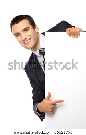 Businessman peeping from behind the blank board - stock photo
