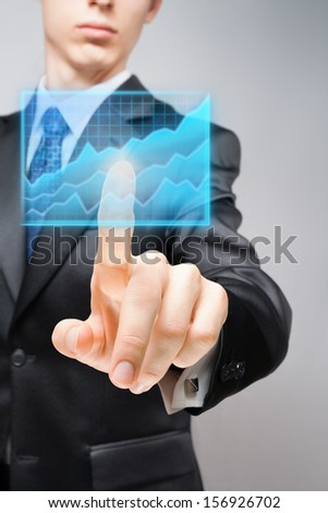 Businessman performing analysis of economic data reporting growth.