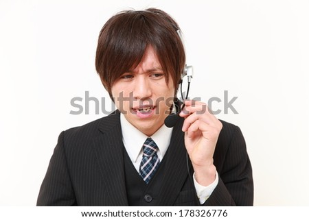 businessman perplexed to a complaint telephone - stock photo