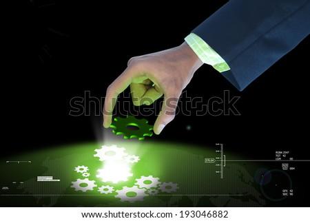 businessman pick the gear elements - stock photo