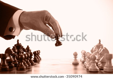 businessman playing chess game sepia tone selective focus - stock photo