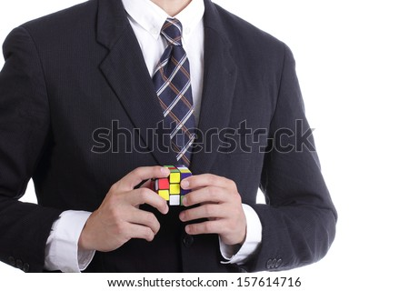 Businessman playing Square puzzle for concept solve solution with white background - stock photo