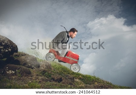 Businessman playing with car and goes down - stock photo
