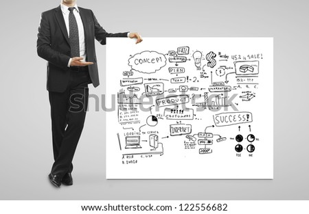 businessman pointing at  business concept - stock photo