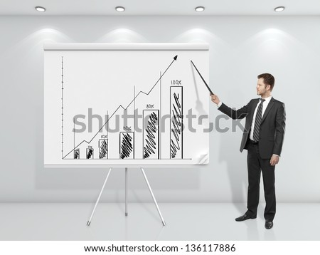 businessman  pointing at business graph on flip chart - stock photo