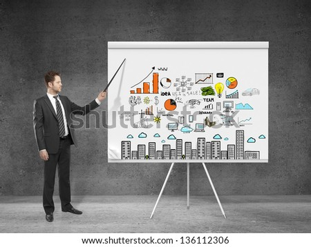 businessman  pointing at business plan on flip chart - stock photo